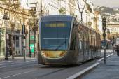 Nice, France, on March 7, 2015. The high-speed tram goes on Jean Medsen Avenue — Stock Photo