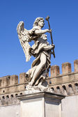 Rome, Italy, on March 6, 2015. The ancient sculptural image of an angel decorating Angel Bridge through the river Tiber — Stock Photo