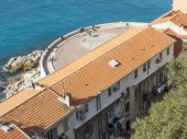 Nice, France, on March 8, 2015. The top view on a house on the seashore — Stock Photo