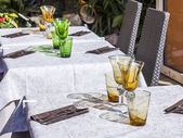 Nice, France, on March 7, 2015. Little tables of summer cafe on the city street — Stock Photo