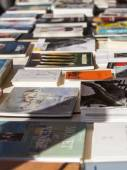 Nice, France, on March 9, 2015. Vintage books on a counter of a flea market on Cours Saleya Square. The Marche Du Cours Saleya market - one of the most known sights of Nice — Stock Photo