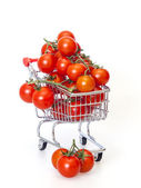 Cherry tomatoes in the store cart — Stock Photo