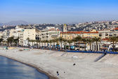 Nice, France, on March 10, 2015. Promenade des Anglais, one of the most beautiful embankments of Europe, and the beach — Stock Photo