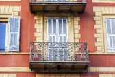 Nice, France, on March 10, 2015. Typical rchitecture  of historical part of the city. Fragment of fasade — Stock Photo