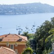 Nice, France, on March 10, 2015. The top view on a bay and the picturesque coast in the suburbs Vilfransh. — Stock Photo #72800839