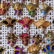 The Venetian masks on a show-window of gift shop. A mask - a typical souvenir from Venice — Stock Photo #72893121