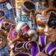 The Venetian masks on a show-window of gift shop. A mask - a typical souvenir from Venice — Stock Photo #72919011