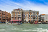 VENICE, ITALY - on APRIL 29, 2015. Ancient palaces ashore Grand channel (Canal Grande). The grand channel is the main transport artery of Venice and its most known channel — Стоковое фото