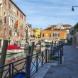 VENICE, ITALY - on APRIL 29, 2015. Typical urban view. Street canal and ancient buildings ashore — Stock Photo #73211313