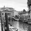 VENICE, ITALY - on APRIL 30, 2015. A typical urban view in rainy weather. Street canal and ancient buildings ashore. Black-and-white image — Stock Photo #73319539