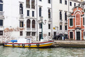 VENICE, ITALY - on APRIL 30, 2015. Old houses ashore Grand channel (Canal Grande). The grand channel is the main transport artery of Venice and its most known channel — Stock Photo