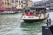 VENICE, ITALY - on APRIL 29, 2015. Vaporetto with passengers floats on the Grand channel (Canal Grande). Vaporetto - public transport in island part of Venice — Stock Photo