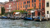 VENICE, ITALY - on APRIL 30, 2015. An architectural complex of ancient buildings on the bank of the Grand channel (Canal Grande). Gondolas at pier. The grand channel is the main transport artery of Venice and its most known channel — Stockfoto