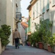 CANNES, FRANCE, on MARCH 12, 2015. The narrow curve street in the old city. — Stock Photo #74029833