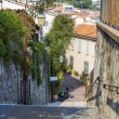 CANNES, FRANCE, on MARCH 12, 2015. The narrow curve street in the old city. — Stock Photo #74029887
