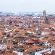 VENICE, ITALY - on APRIL 30, 2015. The top view from San Marco kampanilla on red roofs of houses in island part of the city — Stock Photo #75432267