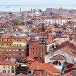VENICE, ITALY - on APRIL 30, 2015. The top view from San Marco kampanilla on red roofs of houses in island part of the city — Stock Photo #75432313