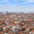 VENICE, ITALY - on APRIL 30, 2015. The top view from San Marco kampanilla on red roofs of houses in island part of the city — Stock Photo #75432551