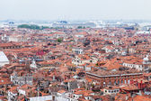 VENICE, ITALY - on APRIL 30, 2015. The top view from San Marco kampanilla on red roofs of houses in island part of the city — Stock Photo