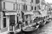 VENICE, ITALY - on APRIL 29, 2015. The gondolas moored at the canal embankment — Stock Photo