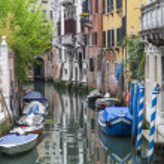 VENICE, ITALY - on MAY 1, 2015. Narrow street canal. Boats are moored near old houses — Stock Photo #76419163