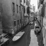 VENICE, ITALY - on MAY 1, 2015. Narrow street canal. Boats are moored near old houses — Stock Photo #76419181