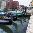 VENICE, ITALY - on MAY 2, 2015. City landscape early in the morning. Gondolas are moored at the coast of the channel — Stock Photo #76652079