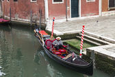 VENICE, ITALY - on MAY 4, 2015. City landscape. Gondola is moored about the coast of the channel — Stock Photo