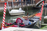 VENICE, ITALY - on MAY 4, 2015. City landscape. Gondola is moored about the coast — Stock Photo