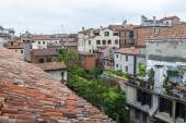 VENICE, ITALY - on MAY 3, 2015. The top view from a window of the house standing on the coast of the channel on roofs of ancient houses — Stock Photo