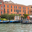 VENICE, ITALY - on MAY 3, 2015. City landscape early in the morning. Gondolas are moored at the coast of the Grand channel (Canal Grande). — Stock Photo #77671562