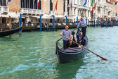VENICE, ITALY - on MAY 3, 2015. The gondola with passengers floats on the Grand channel (Canal Grande) — Stock Photo
