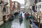 VENICE, ITALY - on MAY 3, 2015. The gondola with passengers floats on the narrow canal street — Stock Photo