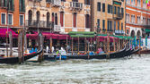 VENICE, ITALY - on MAY 4, 2015. A view from a board vaporetto on the coast of the Grand channel (Canal Grande) and gondola at moorings — Stock Photo