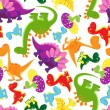 Seamless background pattern of baby dinosaurs — Stock Vector #52942355
