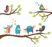 Set of colorful cartoon birds on branches — Stock Vector