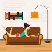 Beautiful girl with laptop on sofa — Vecteur