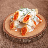 Rolled crepes with caviar — Stock Photo