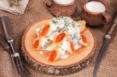 Rolled crepes with caviar and cup of milk — Stock Photo