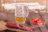Beer and salami — Stock Photo
