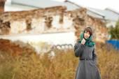 Beautiful alone woman  in grey coat outdoors — Stock Photo