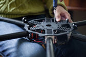 Man's hands assembling multicopter — Stock Photo