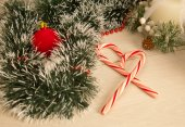 Picture of christmas candy cane, spangle, candle. — Stock Photo