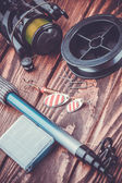 Fishing tackle on a wooden table — Stock Photo