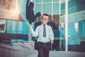 Kid businessman is waving his jacket — Stock Photo