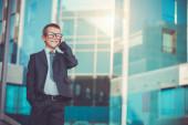 Kid businessman talking on the phone — Stock Photo