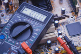 Close-up of multimeter on PCB plate — Stock Photo