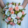 Постер, плакат: Bridal bouquet in the the brides hands