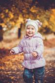 Happy playful baby in the autumn park — Stock Photo