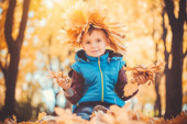Happy playful boy in the autumn park — Stock Photo